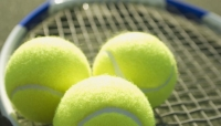 Photo of tennis balls and racket